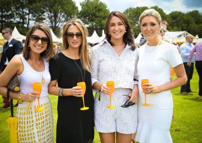 4 female guests holding drinks posing Paspaley Polo in the City Series Australia