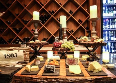 Cheese fruit on platters wine bottles background Pubmatic Ad Revenue Wolgan Valley Conference