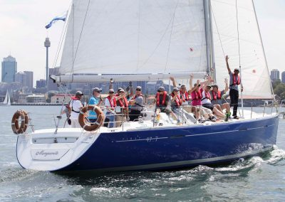 Guests on sailing yacht waving Schlumberger Annual International Conference