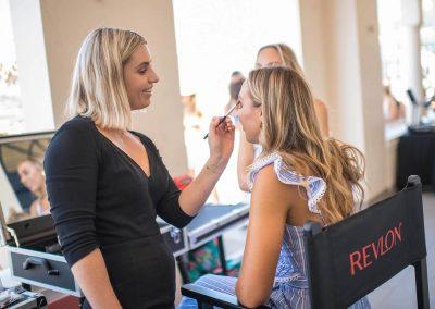 Makeup artist giving guest a sun bronzed makeup look