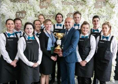 Guests and staff group photo Tabcorp Birdcage Marquee Alfresco Cafe