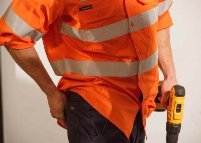 Model high vis shirt holding drill Workwear Industrial Brands Roadshow