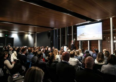 Speaker and audience at Australian Energy Market Commission Annual Staff Day