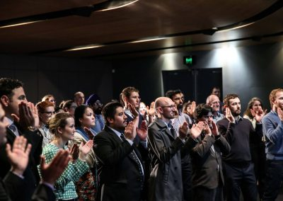 Audience applauding Australian Energy Market Commission Annual Staff Day