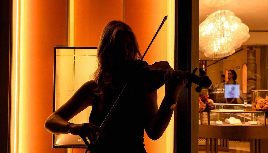 Woman playing violin at Bulgari Sydney launch