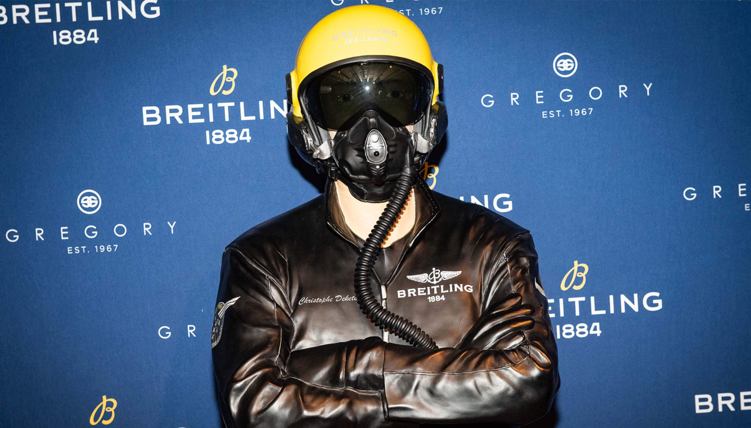 Fighter pilot in helmet, goggles and mask at Breitling event