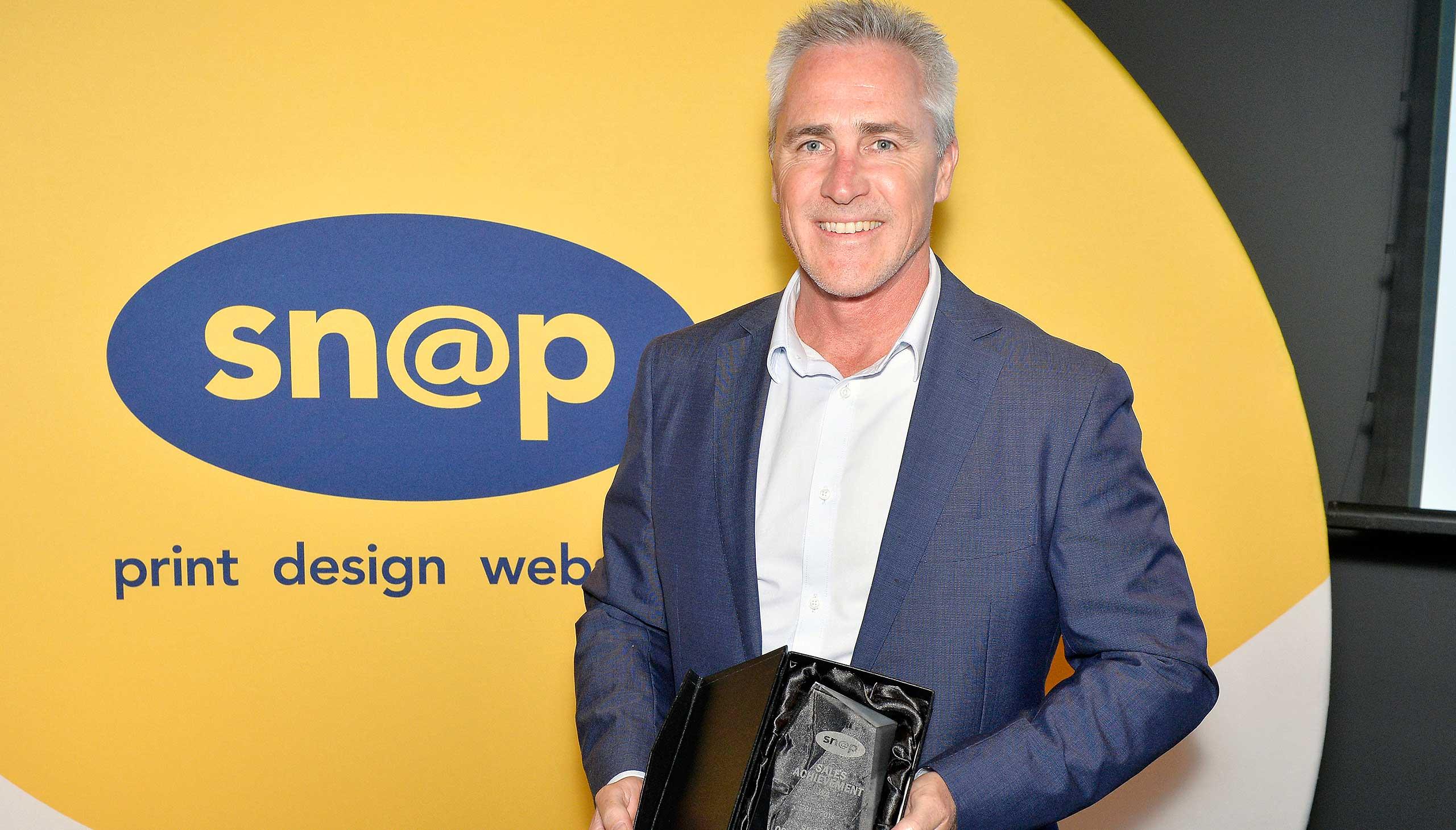 Snap employee receiving an award at event