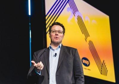 Kieran Perkins speaking at Snap Printing Vision Kick Off