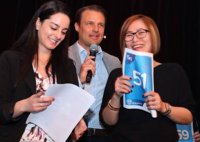 Employees and Speaker on stage at Big Moment Employee Engagement Event